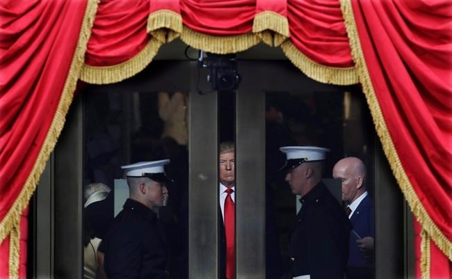 President-elect Donald Trump waits to step out onto the portico for his Presidential Inauguration at the U.S. Capitol in Washington, on Jan. 20, 2017.
