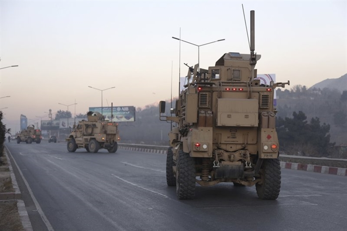 U.S. forces arrive near the Intercontinental Hotel after an attack in Kabul, Afghanistan, Sunday, Jan. 21, 2018.