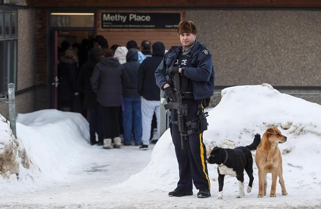 Police stand guard outside court as a provincial court judge decides if a teen who pleaded guilty in the 2016 shooting spree that left four people dead and seven others wounded will be sentenced as an adult in La Loche, Sask. on Friday, February 23, 2018.