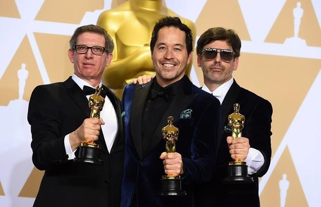 Jeffrey A Melvin, from left, Paul D. Austerberry, and Shane Vieau, winners of the award for best production design for
