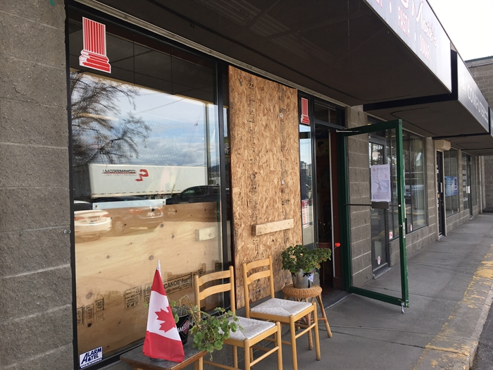 Nicolas & Marie's Pizza is boarded up where thieves smashed the window with a rock, but they're still open and looking at the bright side.
