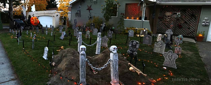 Bones litter the ground near a recently dug grave in a Halloween display at 182 Waddington Drive in Kamloops.