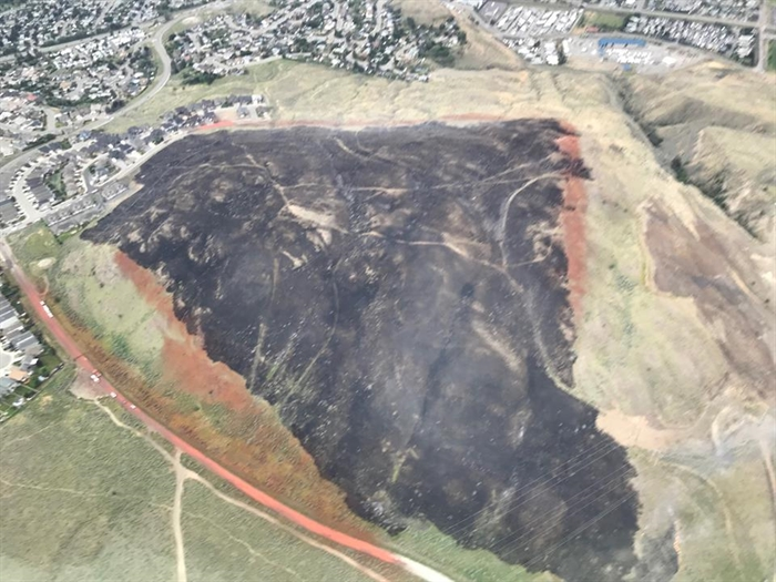 A photo of the Batchelor Heights fire on Thursday, June 21, 2018 showing the fire retardant lines from the air tanker drops. At its peak, the fire was estimated at 60 hectares.