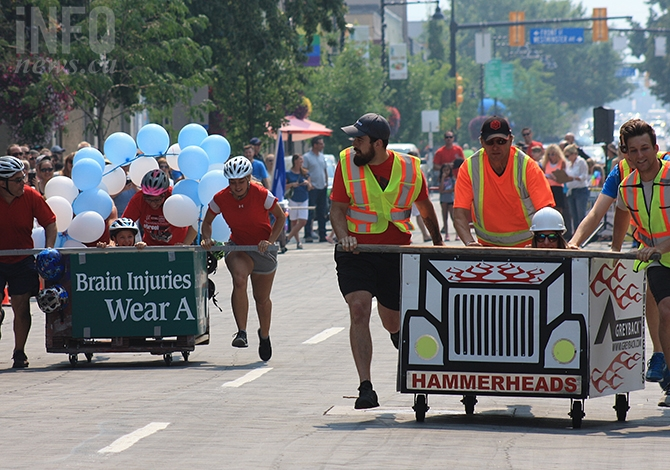 Winner Greyback Hammerheads' peach bin duke it out with the Brain Injury Society's entry in this afternoon's Peach Bin Race in Penticton, Aug. 8, 2018.