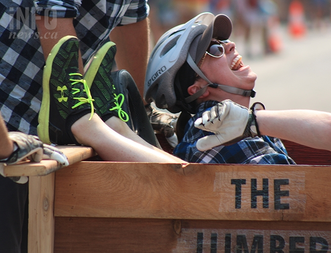 Contestent Dayna Pedro of BP Wood's team the Lumber Rumblers enjoys a laugh during the Peach Bin Race in Penticton, Wednesday, Aug. 8, 2018.