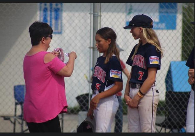 Kadence Martin is given her gold medal after playing with Team B.C. at the Western Canada Baseball Championships.