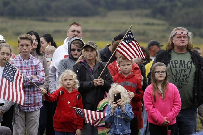 Audience members attend the September 11th Flight 93 Memorial Service, Tuesday, Sept. 11, 2018, in Shanksville, Pa. President Donald Trump is marking 17 years since the worst terrorist attack on U.S. soil by visiting the Pennsylvania field that became a Sept. 11 memorial.