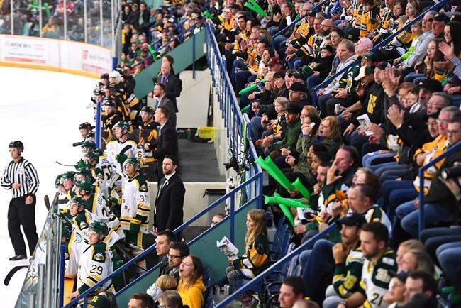 Humboldt Broncos players, new coach Nathan Oystrick and fans look on during second period SJHL hockey action against the Nipawin Hawks in Humbolt, Sask., on Wednesday, Sept. 12, 2018.