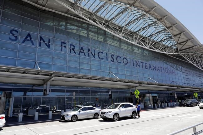 FILE - In this July 11, 2017, file photo, vehicles wait outside the international terminal at San Francisco International Airport in San Francisco.