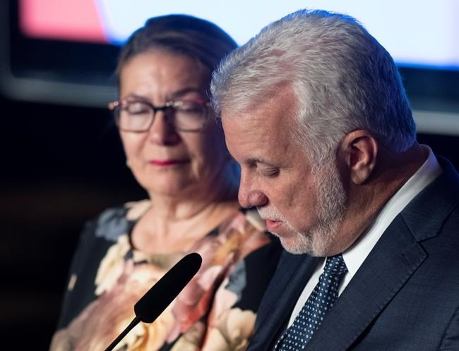 Quebec Liberal Leader Philippe Couillard looks down at his speech as he speaks to supporters after he lost the general election to a majority CAQ government, Monday, October 1, 2018 in Saint-Felicien, Quebec. Couillard's wife Suzanne Pilote looks on.