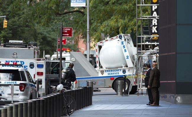 An NYPD bomb squad vehicle departs an area outside Time Warner Center on Wednesday, Oct. 24, 2018, in New York. Law enforcement officials say a suspicious package that prompted an evacuation of CNN's offices is believed to contain a pipe bomb.