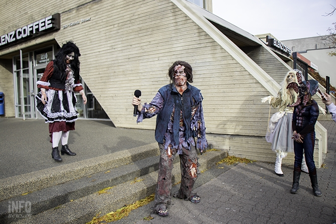 It's time for zombies to come up and give the audience their best groan. Una Connor (centre) takes a turn. Connor is a Kamloops artist and has been doing the zombie walk for about five years. She spent about four hours putting her costume together for today's walk.