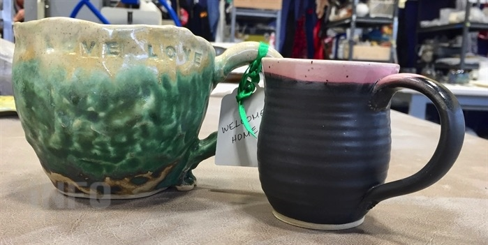 These are two of 50 hand-made mugs from That Pottery Place, donated to the tenants moving into Hearthstone supportive housing next week.