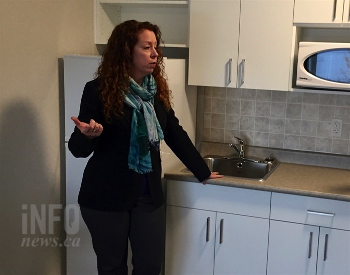 Gaelene Askeland, executive director of John Howard Society, shows the kitchen area of new Hearthstone housing unit in Kelowna, Wednesday, Oct. 31, 2018.