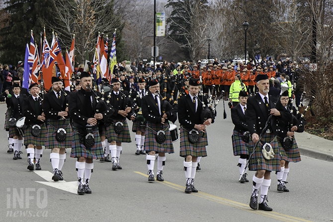 The parade down Victoria Avenue was lead by Kamloops Pipe Band Society. The procession drew a few spectators who stopped to take photos or video on their cellphones. Many wore the red poppy.