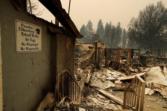 A sign hangs on a wall at the Paradise Elementary School destroyed by the Camp Fire, Tuesday, Nov. 13, 2018, in Paradise, Calif.