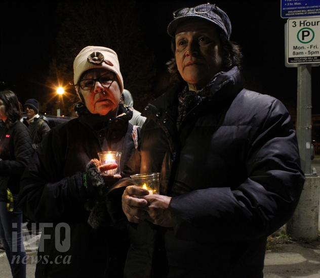 Kamloops Aboriginal Friendship Society addictions counsellor Dee Howse stands with Karen Jules holding candles before the walk for sobriety begins on Wednesday, Nov. 28, 2018.