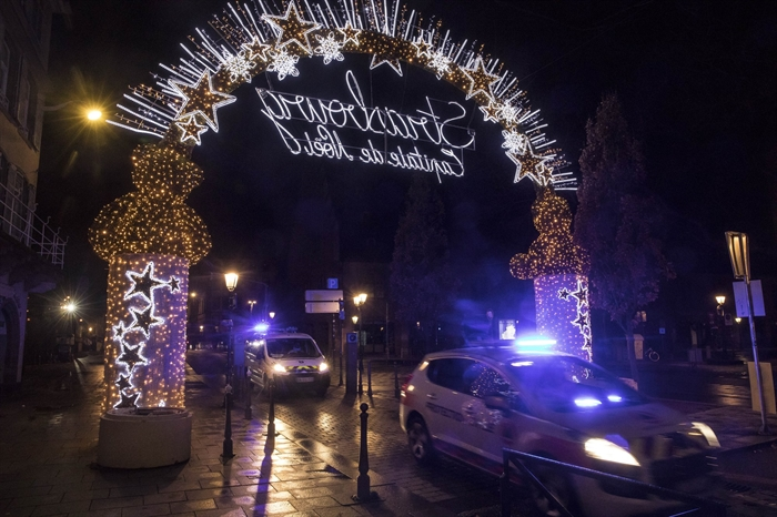 Police vehicles move at the center of the city of Strasbourg following a shooting, eastern France, Tuesday Dec. 11, 2018.