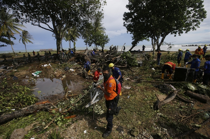 Indonesian rescue team search for the tsunami victims at a beach resort in Tanjung Lesung, Indonesia, Monday, Dec. 24, 2018. Doctors are working to help survivors and rescuers are looking for more victims from a deadly tsunami that smashed into beachside buildings along an Indonesian strait. The waves that swept terrified people into the sea Saturday night followed an eruption on Anak Krakatau, one of the world's most infamous volcanic islands.