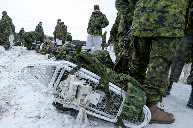 Rucksacks containing, bedding, rations, weapons, clothing and anything else the soldiers will need are lined up in the snow. The sacks can weigh anywhere from approximately 65 pounds (29.5 kilograms) to 95 pounds (43 kilograms) depending on what equipment they take with them.
