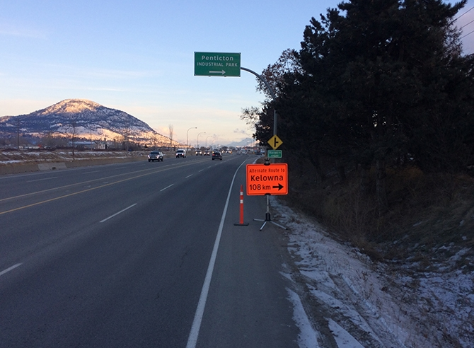 A sign on Penticton's Channel Parkway indicates the alternate route to Kelowna and points north via the 201 Forest Service Road.