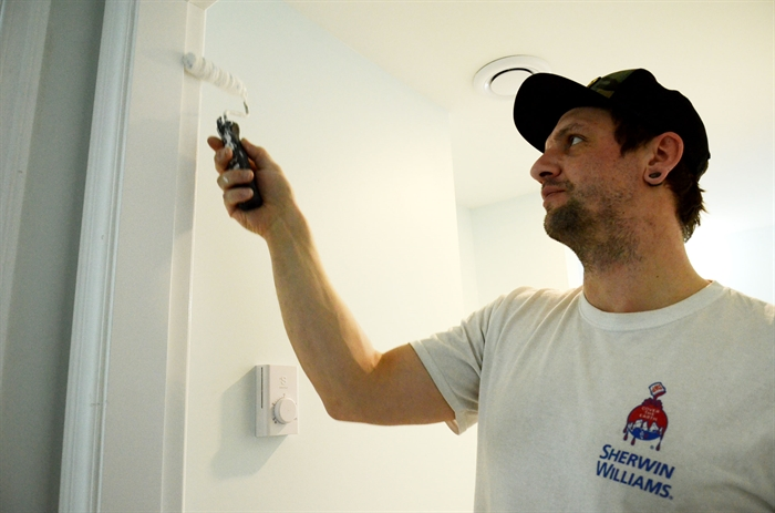 LDR Construction employee Steve Foley adds some paint work during a basement conversion.