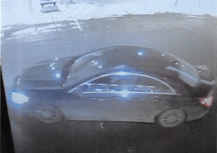 A screen shot of video surveillance shows that the vehicle appears to be a dark-coloured four-door-sedan, with aluminum rims and chrome trim around the driver and passenger door windows. Police say the vehicle may be either a Chrysler, Mercedes or BMW.