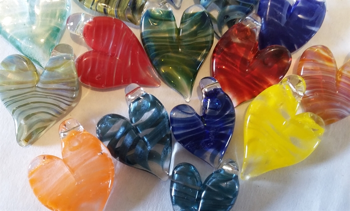 Helen Kovacs' memorial hearts are glass jewellery beads which contain cremated ashes.