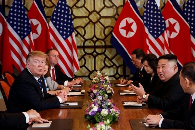 President Donald Trump listens as North Korean leader Kim Jong Un answers a question from reporters during a meeting, Thursday, Feb. 28, 2019, in Hanoi.