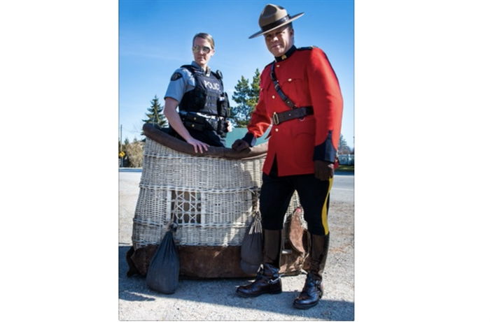 Maple Ridge RCMP officers stand in the hot air balloon basket that's a part of their April Fools' Day announcement. A media release says they will be piloting a hot air balloon program to aide in aerial surveillance.
