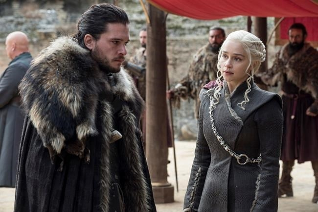 This image released by HBO shows Kit Harington, left, and Emilia Clarke on the season finale of