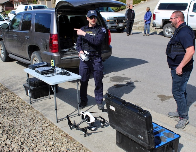 RCMP officers pack up their drone as a standoff with a suspect on Monashee Place in Kelowna, Monday, April 29, 2019, comes to an end with the an arrest.