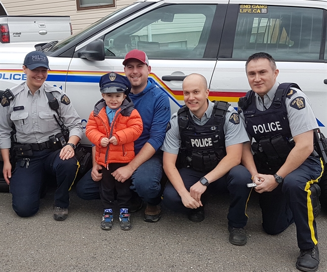 Reid and his father Mike pose with Kamloops RCMP Const. Sine (left), Const. Tucker and Cpl. Blair Wood at his fourth birthday party on Saturday, April 27, 2019.