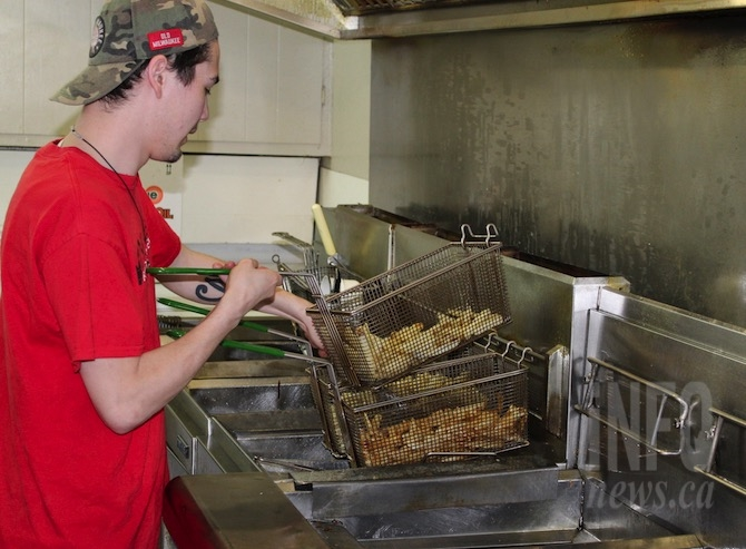 Keanan Mak cooks the hand cut fries at Shady Rest Fish and Chips