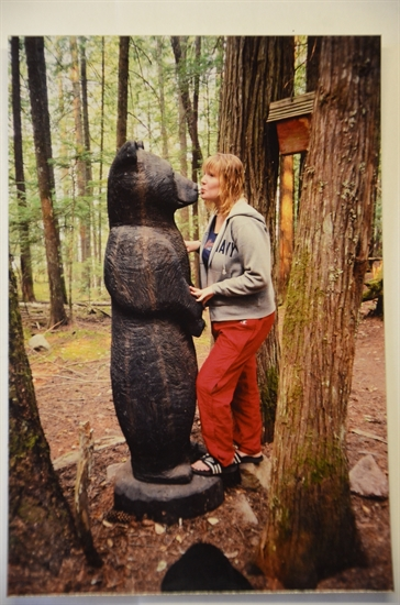 Hannah Briggs with the bear carved by Fern Makarenko 2003.