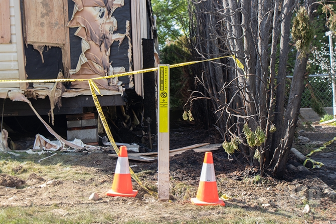 A gas line marker is seen below where the blaze took place.