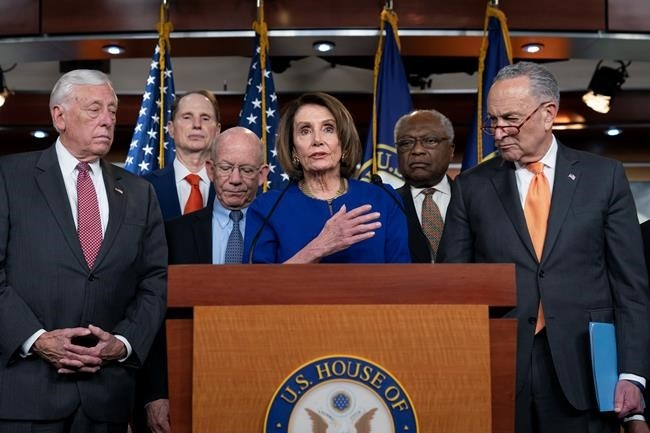 Speaker of the House Nancy Pelosi, D-Calif., center, Senate Minority Leader Chuck Schumer, D-N.Y., right, and other congressional leaders, react to a failed meeting with President Donald Trump at the White House on infrastructure, at the Capitol in Washington, Wednesday, May 22, 2019. From left are House Majority Leader Steny Hoyer, D-Md., Sen. Ron Wyden, D-Ore., House Transportation and Infrastructure Committee Chair Peter DeFazio, D-Ore., Pelosi, House Majority Whip James E. Clyburn, D-S.C., and Schumer.