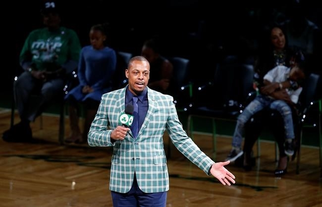 Former Boston Celtics Paul Pierce address the crowd during a ceremony to retire his number following an NBA basketball game against the Cleveland Cavaliers in Boston, Sunday, Feb. 11, 2018. Even when Pierce says something good about the Raptors, Toronto fans just can't get behind the former NBA all-star.