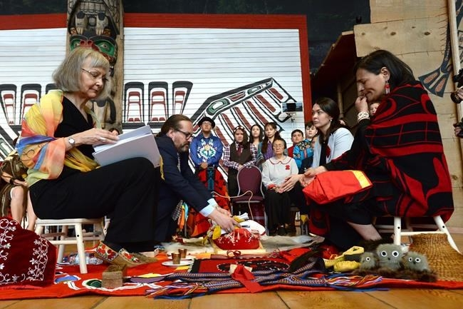 Chief commissioner Marion Buller, left to right, and commissioners Brian Eyolfson, Qajaq Robinson and Michele Audette prepare the final report to give to the government at the closing ceremony for the National Inquiry into Missing and Murdered Indigenous Women and Girls in Gatineau, Que., on Monday, June 3, 2019.