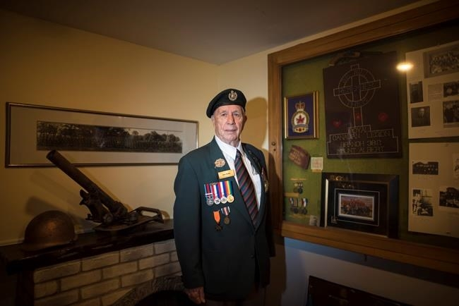 D-Day veteran Jim Parks, 94, poses for a photograph at the Mount Albert Legion in Newmarket, Ont., on Thursday, May 30, 2019.