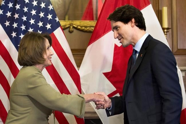 Canadian Prime Minister Justin Trudeau shakes hands with House Minority Leader Nancy Pelosi of Calif. prior to their meeting on Capitol Hill in Washington, Thursday, March 10, 2016. Justin Trudeau and U.S. House Speaker Nancy Pelosi are placing a bet on the NBA Finals, with the prime minister putting bagels and beer up against wine and chocolate.