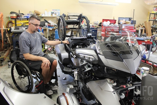 Tyler Tingle is seen working on his Spyder bike at his home in Westsyde. He modified the foot brakes into hand controls and added a wheelchair rack.