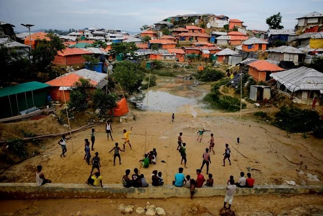FILE- In this Aug. 27, 2018 file photo, Rohingya refugees play at Balukhali Refugee Camp in Bangladesh.