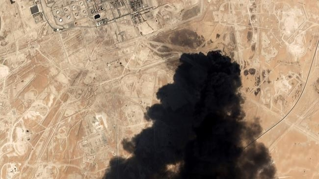 FILE - In this Saturday, Sept. 14, 2019 file photo, a satellite image from Planet Labs Inc. shows thick black smoke rising from Saudi Aramco's Abqaiq oil processing facility in Buqyaq, Saudi Arabia. The assault on the beating heart of Saudi Arabia's vast oil empire follows a new and dangerous pattern that's emerged across the Persian Gulf this summer of precise attacks that leave few obvious clues of who launched them.