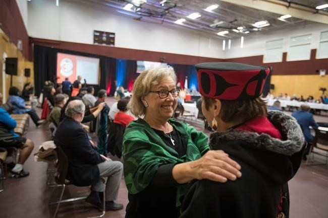 Green Party Leader Elizabeth May, left, and NDP candidate for Central Okanagan-Similkameen-Nicola, and wife of Grand Chief Stewart Phillip, Joan Phillip, greet each other before speaking at the B.C. Assembly of First Nations annual general meeting at the Musqueam First Nation, in Vancouver on Thursday, Sept. 19, 2019.