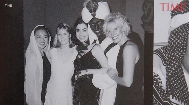 A photo showing Prime Minister Justin Trudeau, second from right, at a 2001 costume party - his hands and face blackened with makeup -- was published by Time Magazine Wednesday. They say it was published in the yearbook from the West Point Grey Academy, a private school in Vancouver, B.C., where Trudeau worked as a teacher before entering politics.