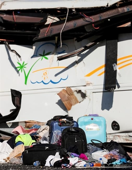 Luggage sits on the roadway at the scene where at least four people were killed in a tour bus crash near Bryce Canyon National Park, Friday, Sept. 20, 2019, in Utah.