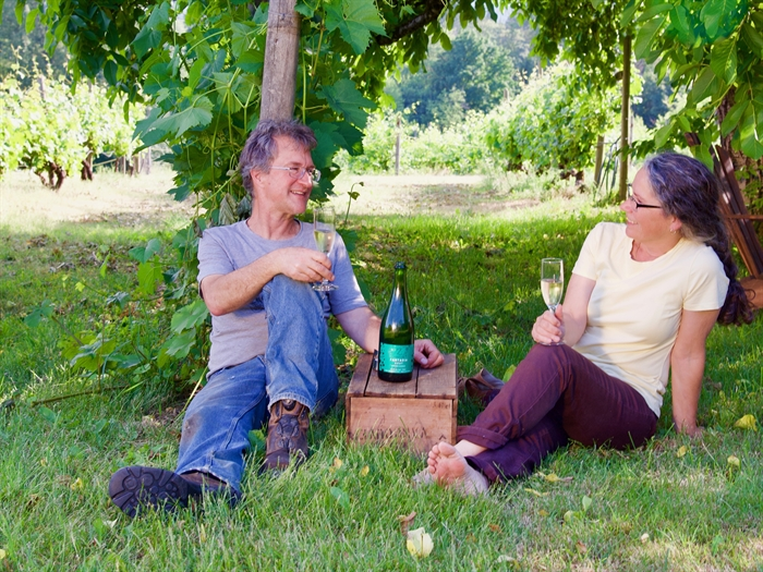 Vigneti Zanatta Winery owners Jim Moody and Loretta Zanatta taking a break in their vineyard after a long day.