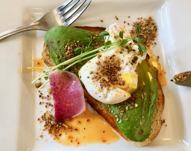 Breakfast at Artisan Eats is a MUST! Poached eggs on avocado toast with dukkah is my fave