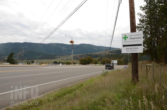 Signs on Highway 97 advertise pot shops on Westside Road.